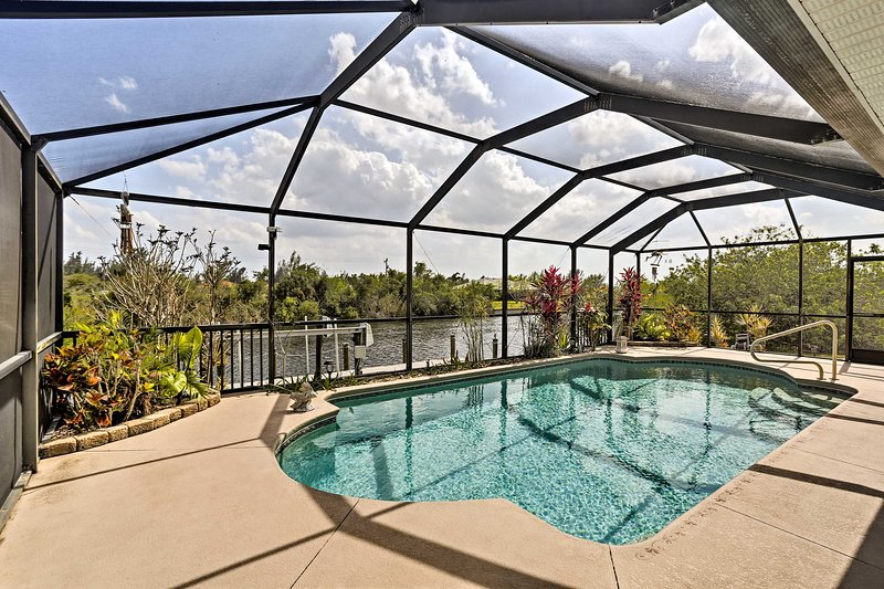A waterfront view and screened in pool scream the perfect Florida vacation!