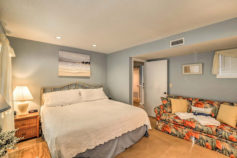 The master bedroom boasts a king-sized mattress.