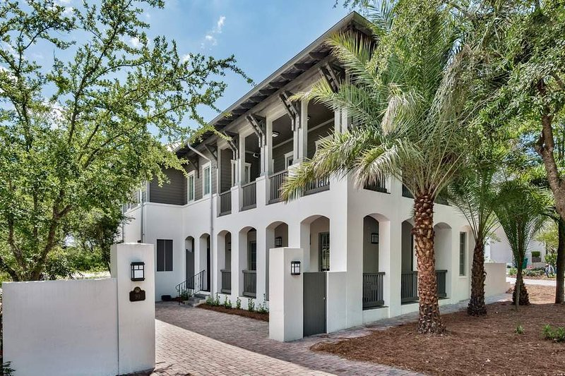 Before you step through the front door, pause for a moment to admire the Spanish revival architecture of this home.