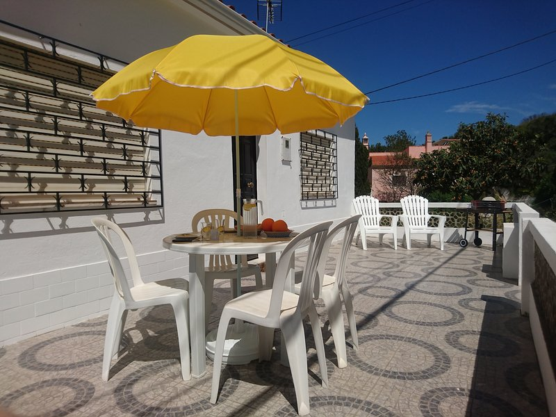Sunny private terrace with BBQ and plenty of seating and shade