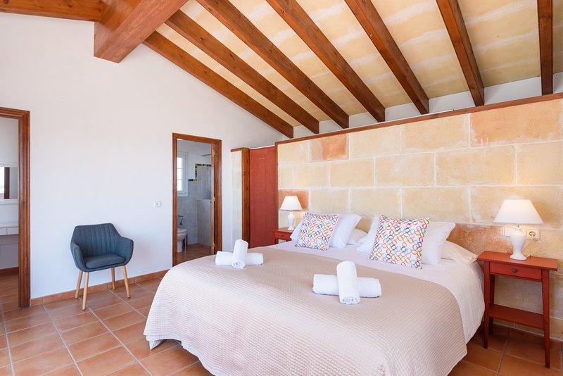 Camera da letto suite superior con aria condizionata.