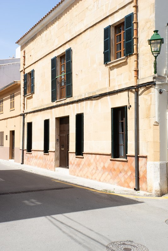 Main entrance to the house with façade typical Majorcan Mares-stone