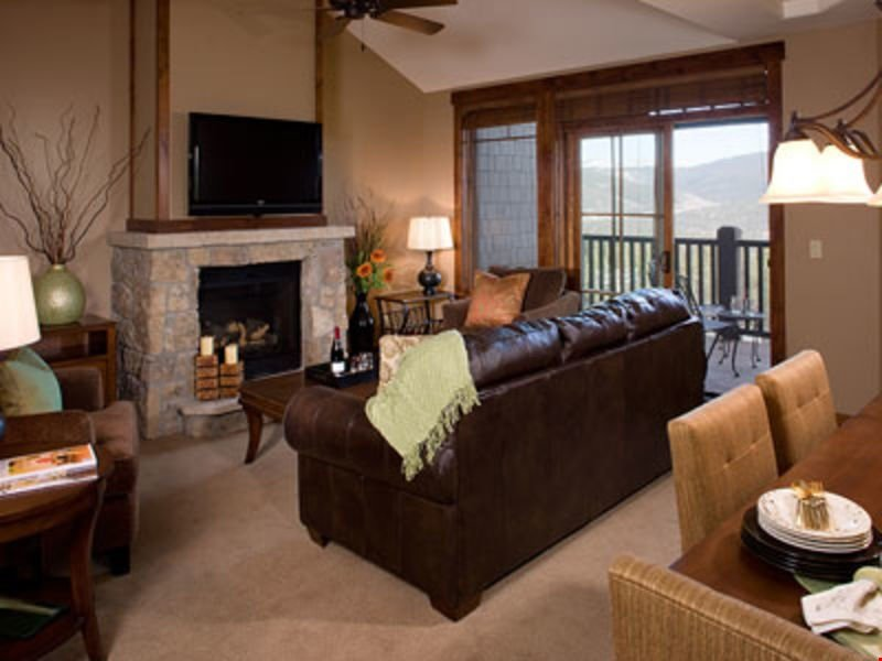 Relax in the luxurious living area, complete with a stone gas fireplace