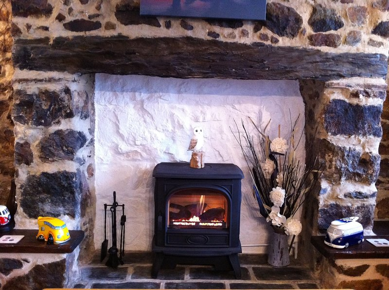 Lounge inglenook fireplace with gas log effect stove