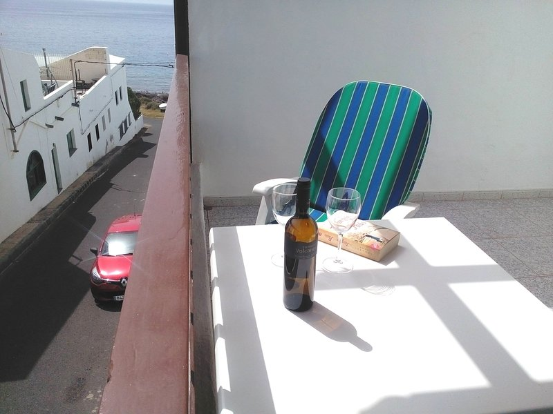 Terrace idea to read with natural light accompanied with a good wine from Lanzarote