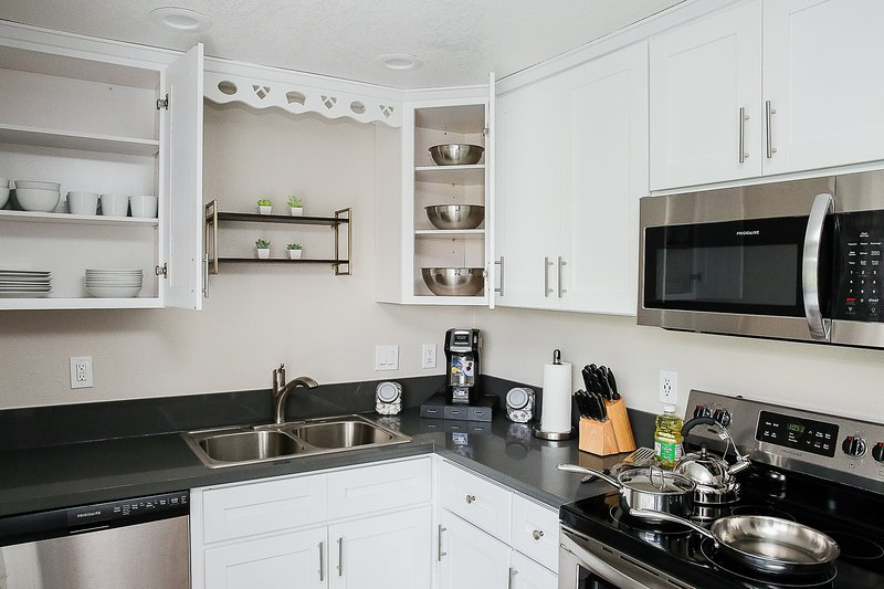 A fully stocked kitchen giving you the option to enjoy meals at home