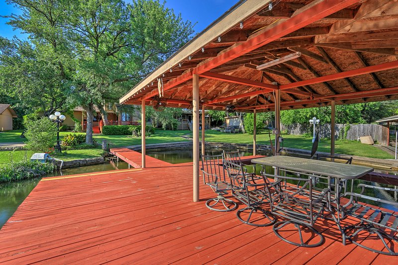 From the private dock to the upscale porch, this house has it all!