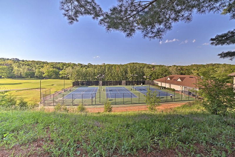 Hit the courts and play a tennis match.