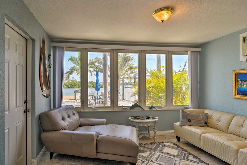 Relax in the seashell yard and dolphin watch when you book this coastal rental!