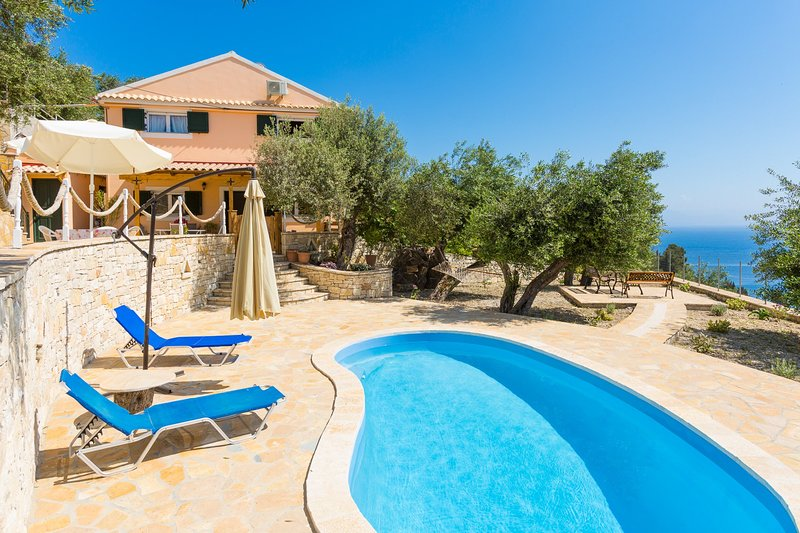 Beautiful villa with private pool, multi-level terrace area, and sea views