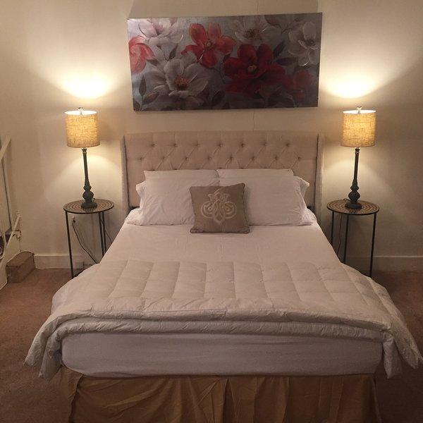 Comfortable cozy queen size bed in second bedroom. New bed and foam mattress. Great sleeping.
