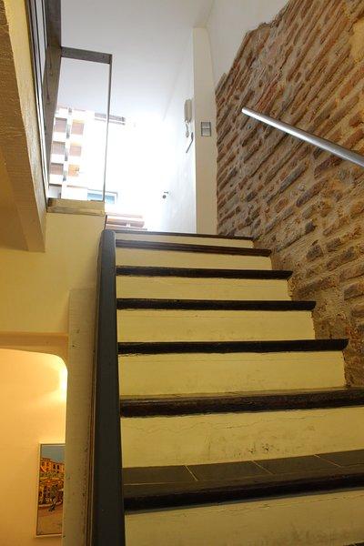 Tastefully renovated apartment with original brickwork exposed