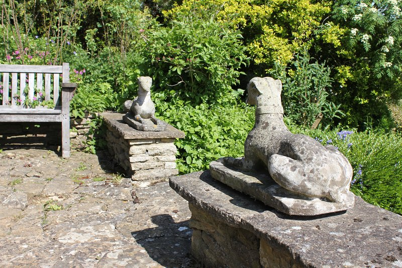Back steps to garden with statues and bench