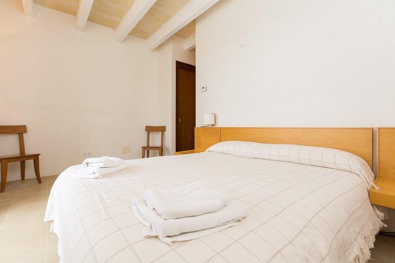 Camera matrimoniale con bagno privato e accesso alla terrazza