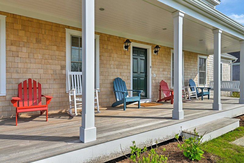 Kick back and unwind with a cocktail on the front porch after a day at the beach