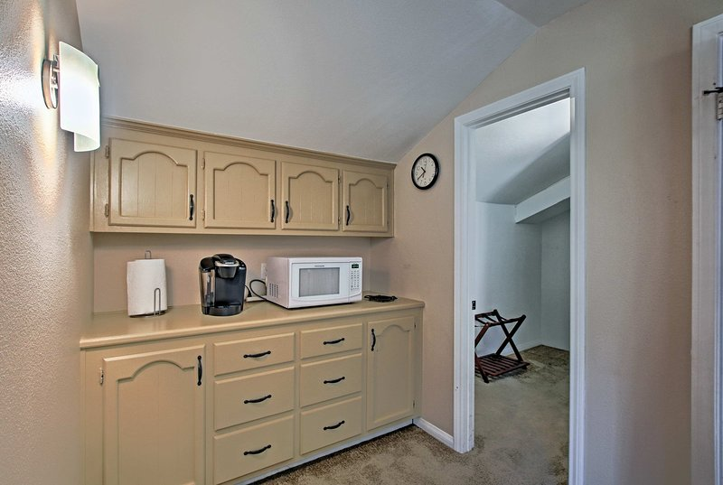 You'll also find a small kitchenette setting with a Keurig machine.