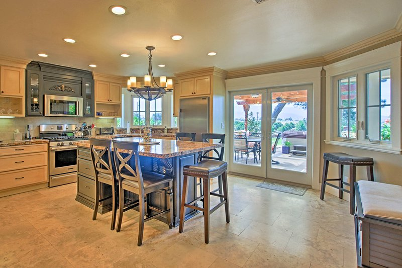 The large eat-in kitchen is perfect for socializing and cooking up tasty favorites.