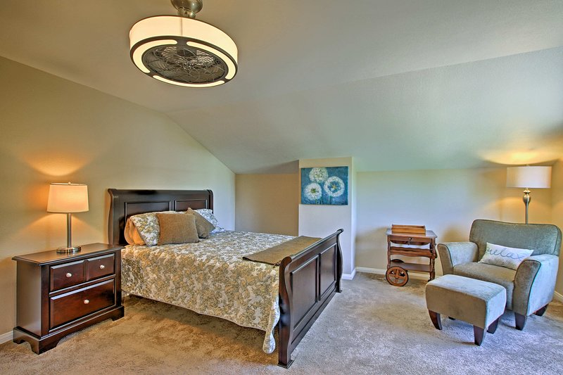 Upstairs, this queen bedroom boasts vaulted ceilings.
