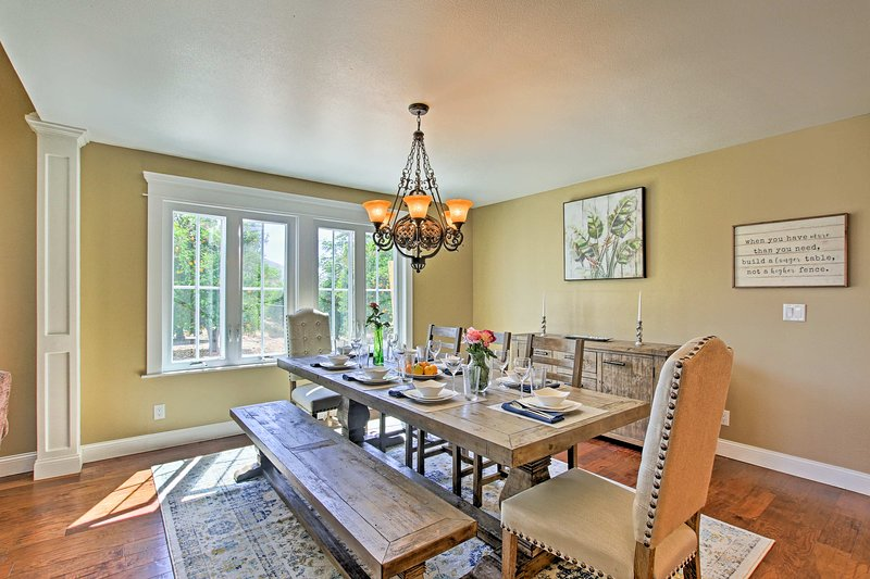 Combination bench seating is featured at the elegant dining table.