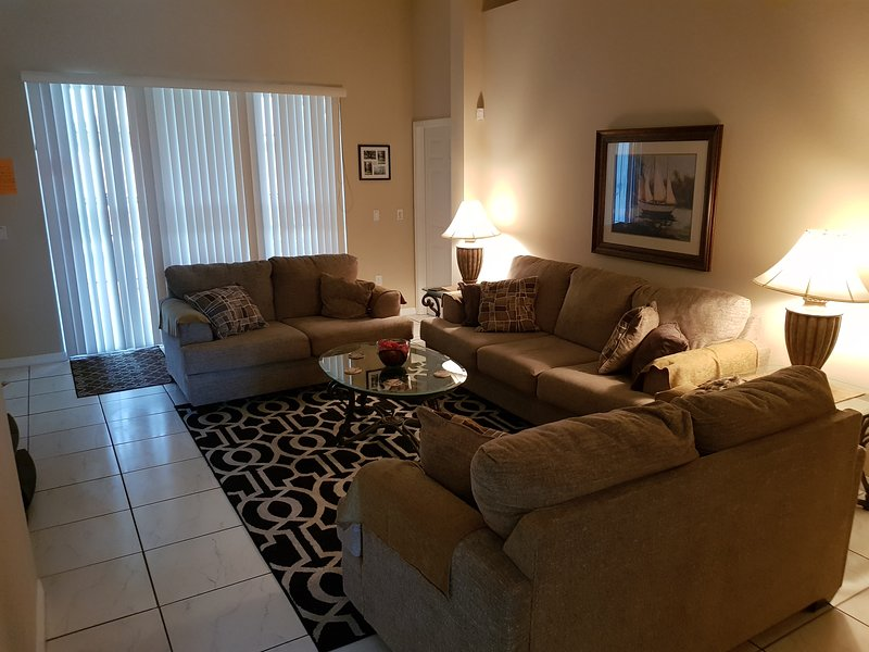 Large Living Room with 3, 3, and 4, seater sofas