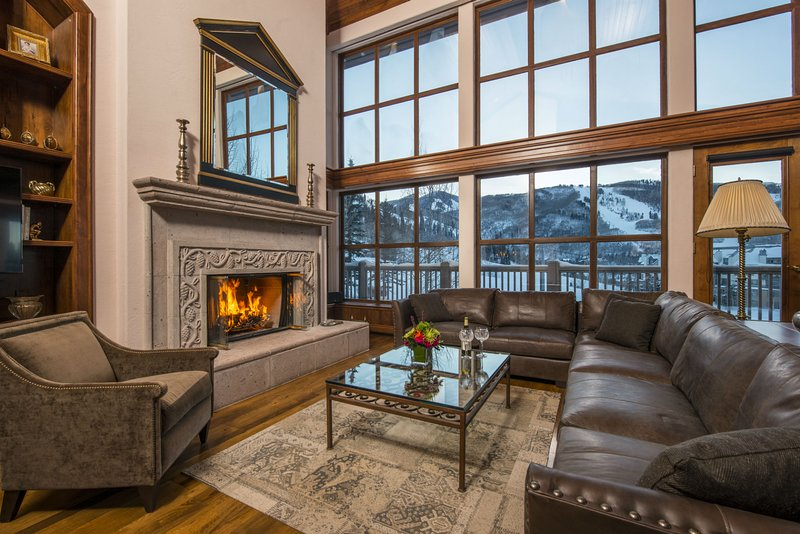 Living room with wood-burning fireplace.