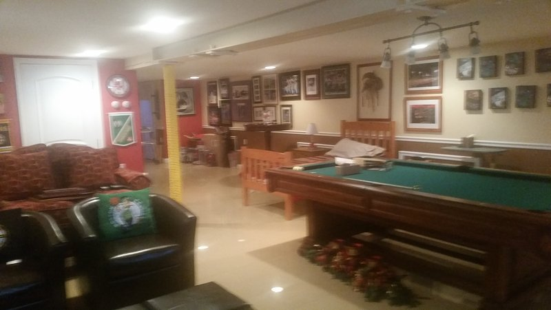 60' TV on wall, loveseat, pool table, Round table and chairs. Awesome room $58,000
