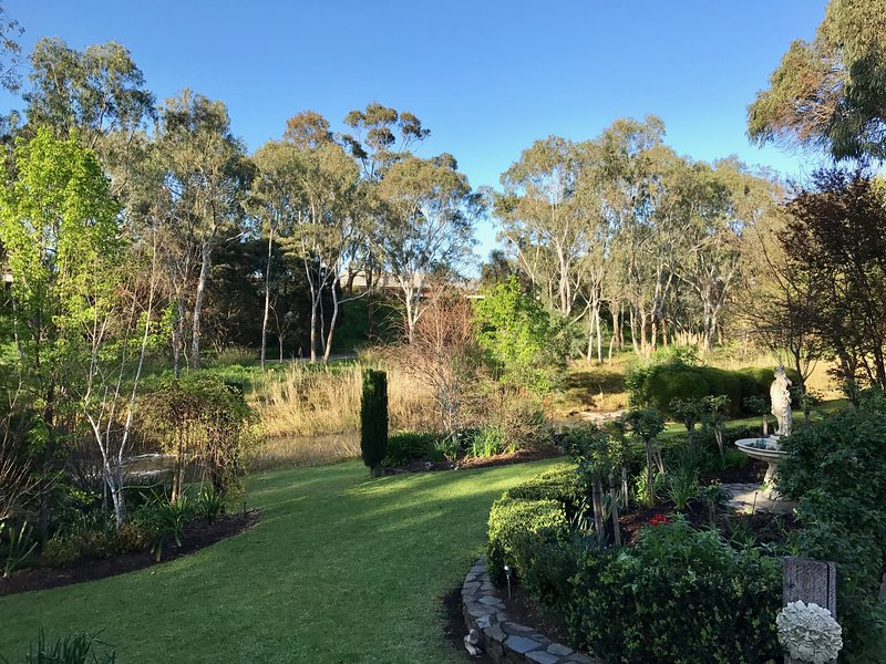 stunning landscaped grounds over an acre
