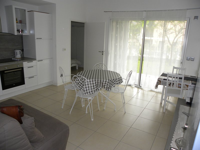 New splendid apartment with private garden, swimming pool and private car garage
