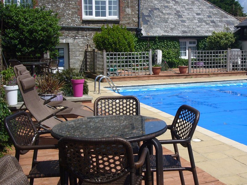Enjoy relaxing around the shared heated swimming pool