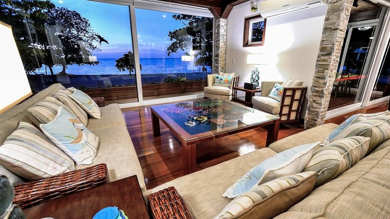 View of beach and sea at sunset from living room