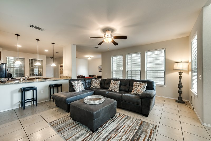 Large open floor plan living room, kitchen and dining room.