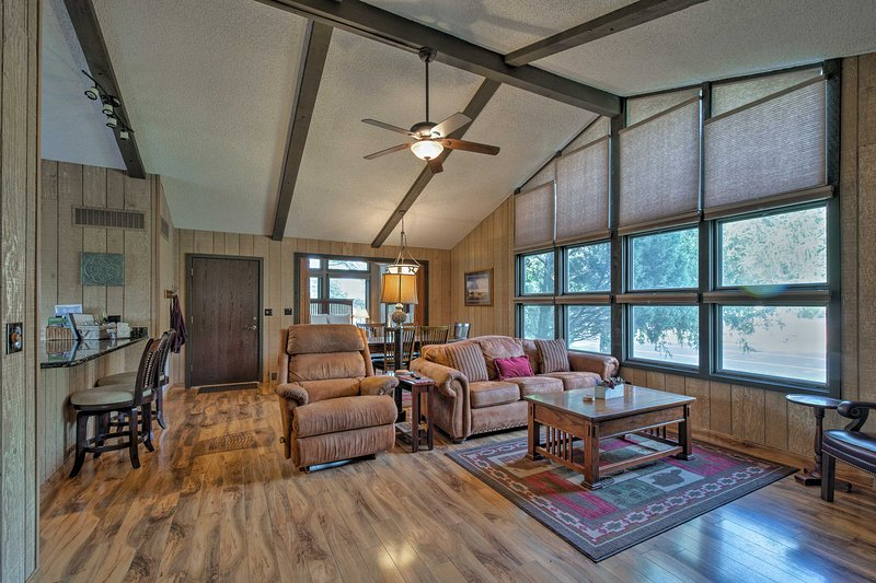 The great room features floor-to-ceiling windows overlooking the golf course!