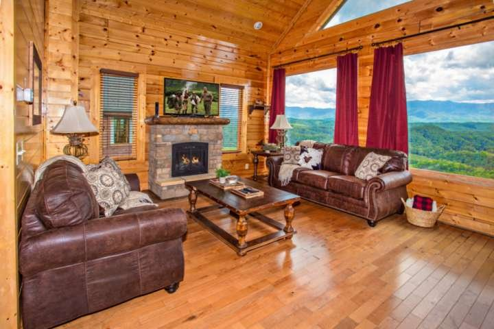 Comfortable seating in main living room area with Flat Screen TV and Seasonal Fireplace and great views!