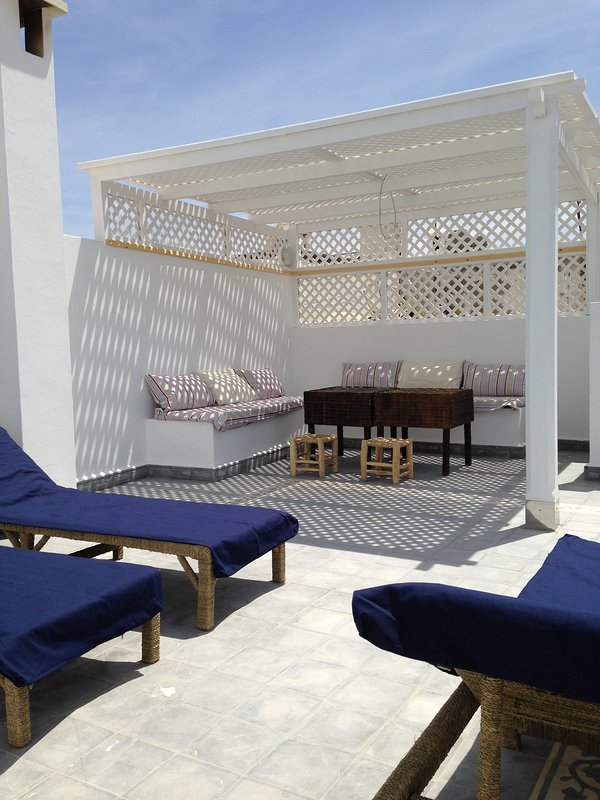 sun terrace and space meal shaded from the sun, kitchen adjoining summer, refrigerator, griddle