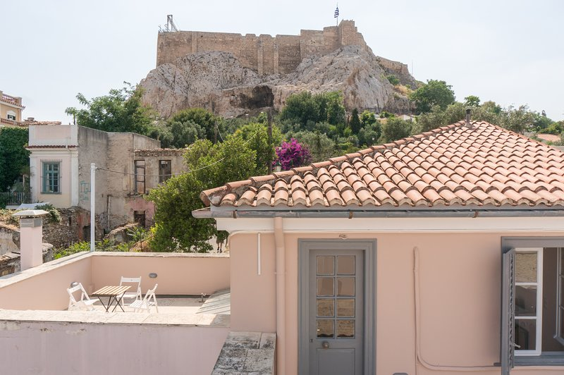 Take your morning coffee under the sacred rock of Athens