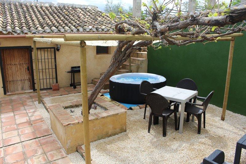Grapevine Cottage - Pátio privado