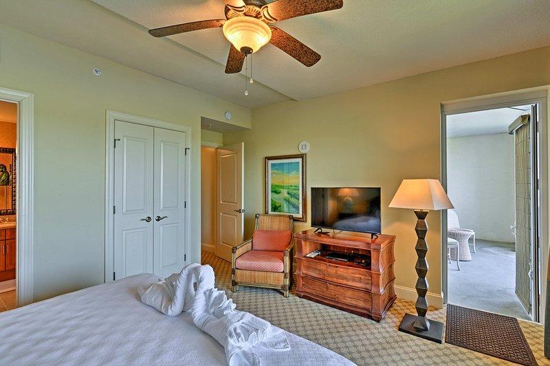 The second bedroom has 2 doorways to access the balconies.