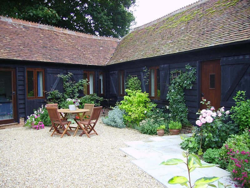 Sunny courtyard seating area at Blackberry Barn