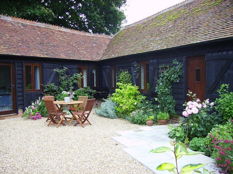 Soleado patio zona de asientos en Blackberry Barn
