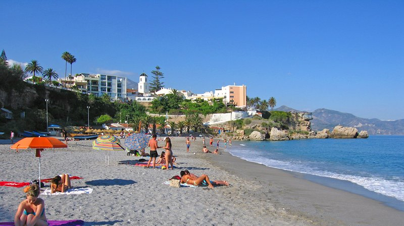 El Salon beach - nice sandy beach with loungers and showers, 5 minutes walk from the apartment
