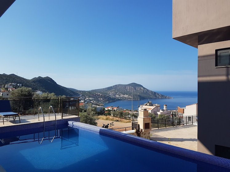 Relax by the pool and take in the bay
