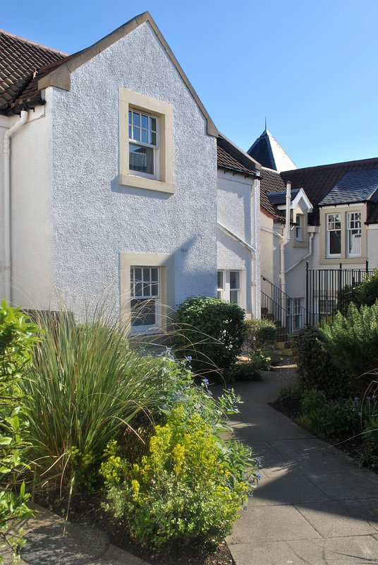 The ground floor apartment is set within well maintained grounds