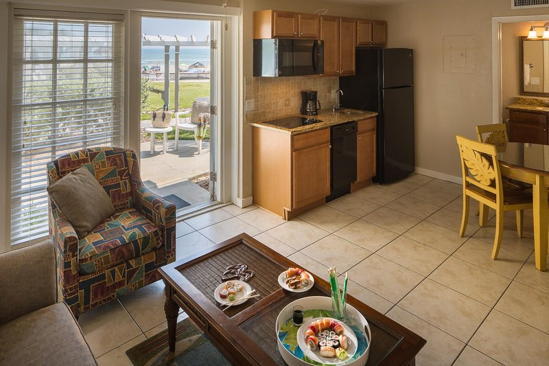 Coconut Palms Beach Resort II Studio Seating and Kitchenette