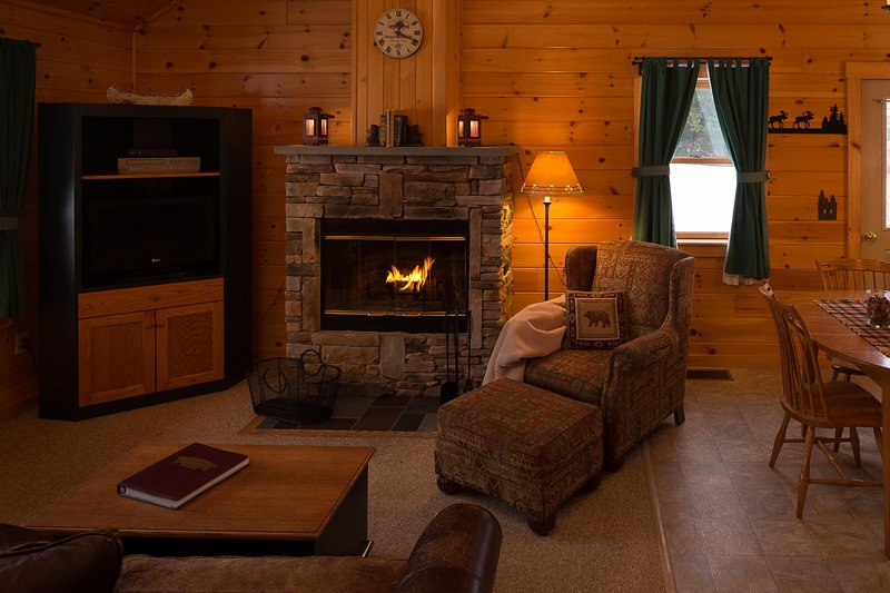 Rangeley Lake Resort Living and Dining Area with Fireplace