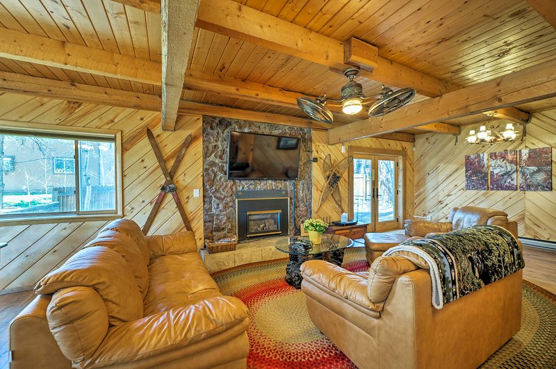 The 3-bedroom, 1.5-bathroom cabin exudes quintessential mountain living.