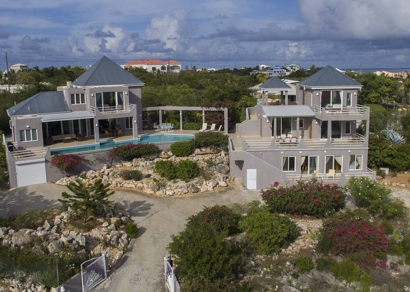 Aerial view of Villa Gardenia showing the master bedroom, outdoor lounge, dining table on the main v
