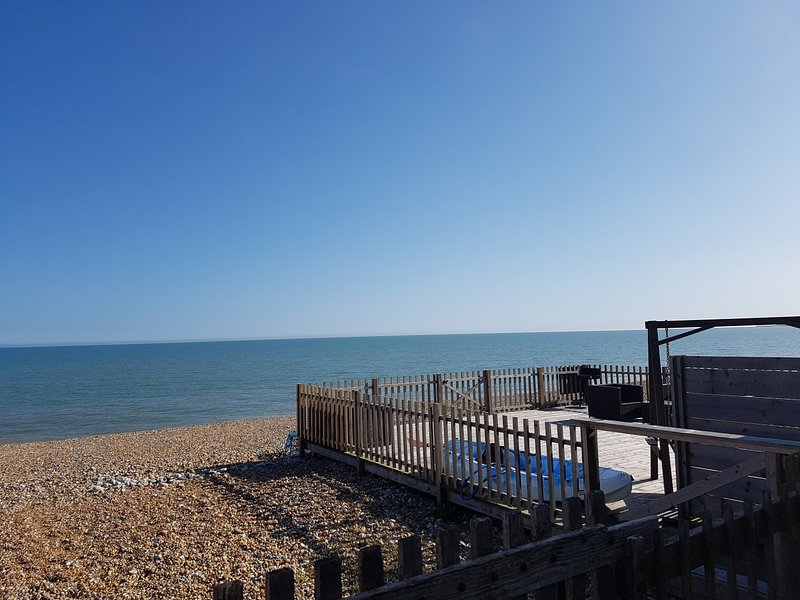 view of the beach from the decking