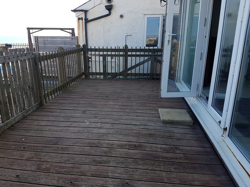 decked rear patio directly on the beach