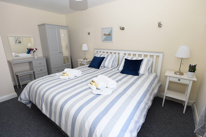 The master bedroom with super king size bed. There is also a wardrobe and dressing table.
