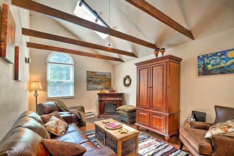 This 2-bedroom + studio, 2.5-bath vacation rental cabin sleeps up to 6.